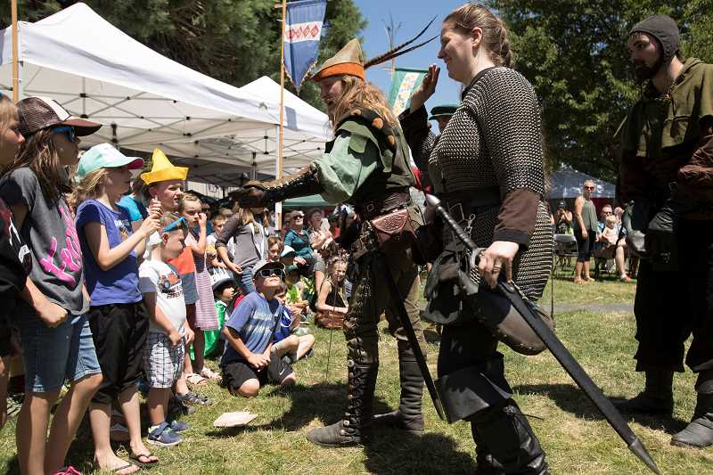 PAMPLIN MEDIA GROUP: JAIME VALDEZ - Actors from the Seattle Knights greet children before sword fighting during the 2017 Robin Hood Festival. Photo by Jaime Valdez