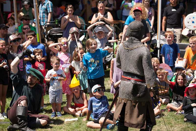 PAMPLIN MEDIA GROUP: JAIME VALDEZ - Children in the crowd taunt the Seattle Knights during the 2017 Robin Hood Festival. Photo by Jaime Valdez