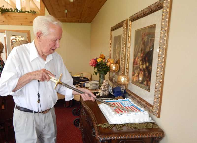 Bob Santee, who served in the Marines Corps in World War II, the Korean War and the Vietnam War, used one of his swords to cut the cake he brought for dessert.