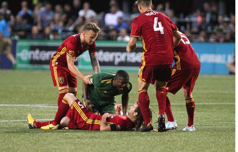 TRIBUNE PHOTO: JAIME VALDEZ - Portland Timbers forward Fanendo Adi (9) confronts Real Salt Lake midfielder Kyle Beckerman (5) in the second half at Providence Park