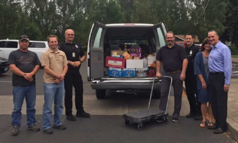 COURTESY OF STUART MASON - Timberline Baptist Church and Timberline Learning Center recently collected from their membership a variety of snacks and beverages for the Sherwood Police Department and the TVFR Sherwood station No. 33. From left are David Garrett, John Couillette, Captain Mark Daniel, Chief Jeff Groth, Captain Ty Hanlon, Toni Mason, and Pastor Stuart Mason.