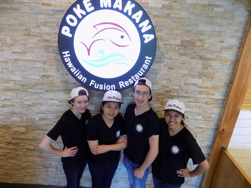 GAZETTE PHOTO: RAY PITZ - Sherwoods Poke Makana takes a different take on Hawaiian food with its fusion bowls and burritos. From left are, Abby Mortensen, owner Livia Chen, Chandler Everett and Kylie Kushiyama.