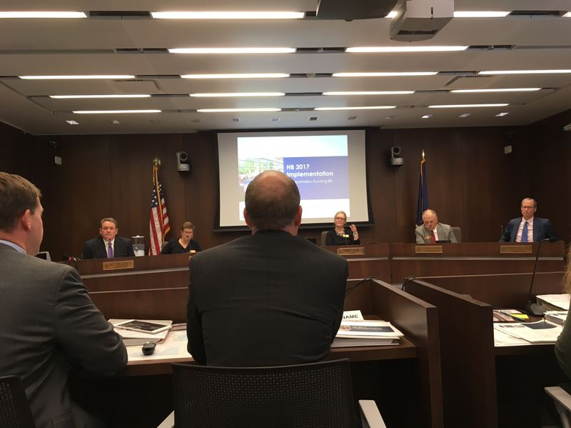 PAMPLIN MEDIA GROUP: PETER WONG - Oregon Transportation Commission members hear details of the recently approved transportation funding bill (HB 2017) approved by the 2017 Legislature at a meeting Thursday, July 20. Seated from left is Travis Brouwer, assistant director for public affairs, and Paul Mather, Highway Division chief, Oregon Department of Transportation.