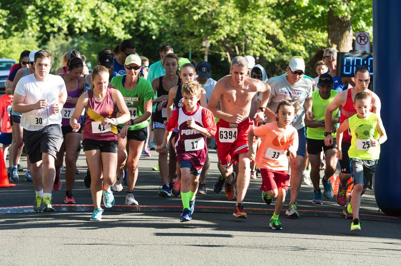 NEWS-TIMES PHOTO: CHRISTOPHER OERTELL - Twenty nine runners began the 10K Viking Vengeance race on Thursday July 20th. Zach Gingerich (#6394), a 38 year old runner from Newberg, won the race with a time of 36:31.