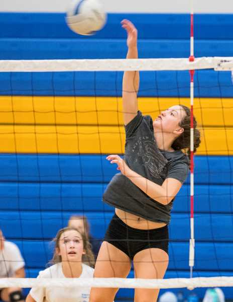 LON AUSTIN/CENTRAL OREGONIAN - Crook County High School senior outside hitter Cassidy Dill goes up for a kill, while sophomore Stormie Camara covers any possible blocks. The players were in the gym last Friday through Monday as part of the annual Rimrock Volleyball Team Camp.
