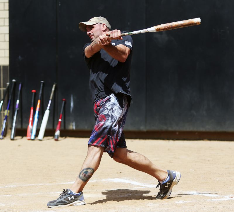 DAN BROOD - Josh Burnham, a 1996 Tualatin High School graduate, takes a swing during Sunday's Gary Edwards Memorial Softball game.