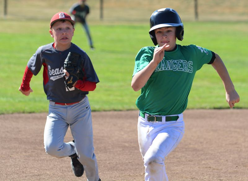 ESTACADA NEWS: DAVID BALL - Estacadas Tucker Jackson wins a foot race to third base against a Seaside infielder during Fridays 13-7 loss in an elimination game at the JBO state tournament.