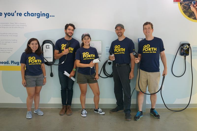 PORTLAND TRIBUNE: JEFF ZURSCHMEIDE - The staff of the new Go Forth Electric Vehicle showcase at their grand opening, with Forth Executive Director Jeff Allen on the right.