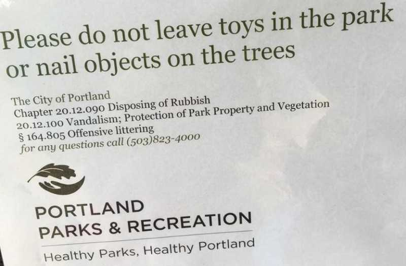 PHOTO COURTESY OF DONNA HERRON - In August 2016, signs cropped up on bulletin boards outside the Maricara park calling the fairy doors, a majority of which had also been removed, 'Offensive littering.' Though they bork the Portland Parks logo, the department says it had nothing to do with the door removals.