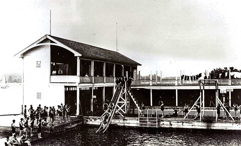 COURTESY OF OREGON HISTORICAL SOCIETY - In the center is the young mens slide, at the Windemuth Bath House at the northern tip of Ross Island, in the 1920s. The Windemuth Baths could only be accessed by boat or launch, but was nonetheless a popular tourist attraction.