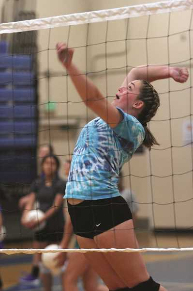 PHIL HAWKINS - Woodburn junior Bailey Woolley rises up at the net during summer practice on Wednesday.