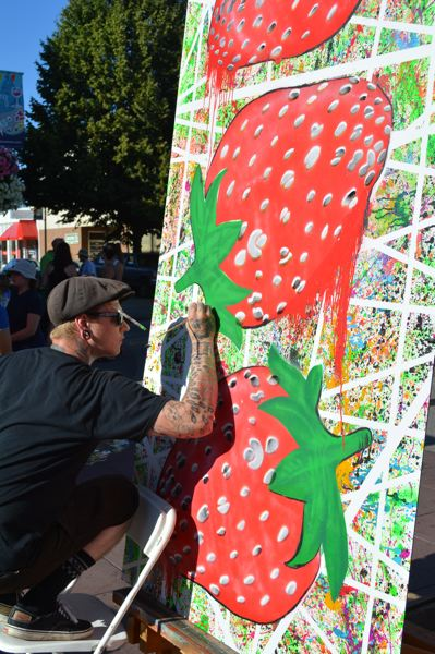 NEWS-TIMES/HILLSBORO TRIBUNE PHOTO: KATHY FULLER - Joshua Gundersen works on a 4-by-8-foot panel during Tuesday Night Market, part of a new mural that will hang on a building along Main Street.