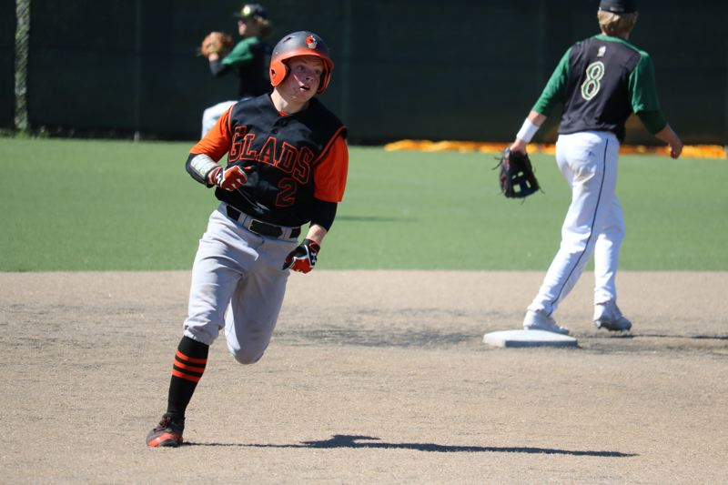 REVIEW/NEWS PHOTO: JIM BESEDA - Gladstone's Matthew Lehrbach heads for third base on a fifth-inning triple in Wednesday's 4-2 loss to Jesuit at the OIBA tournament at Wilsonville High School.