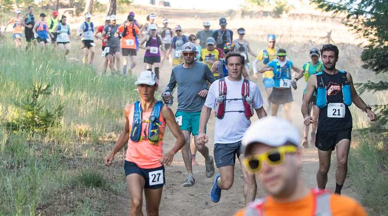 LON AUSTIN/CENTRAL OREGONIAN - Runners run down a steep hill near the starting line of the Ochoco Trial Runs 50K, which was held Saturday, beginning at Walton Sno Park. Matt Palilla, No. 21, of Bend, was the overall winner of the race, while Kami Semick, No. 27, was the women's winner. Of the 31 runners who started the race, most were able to finish.