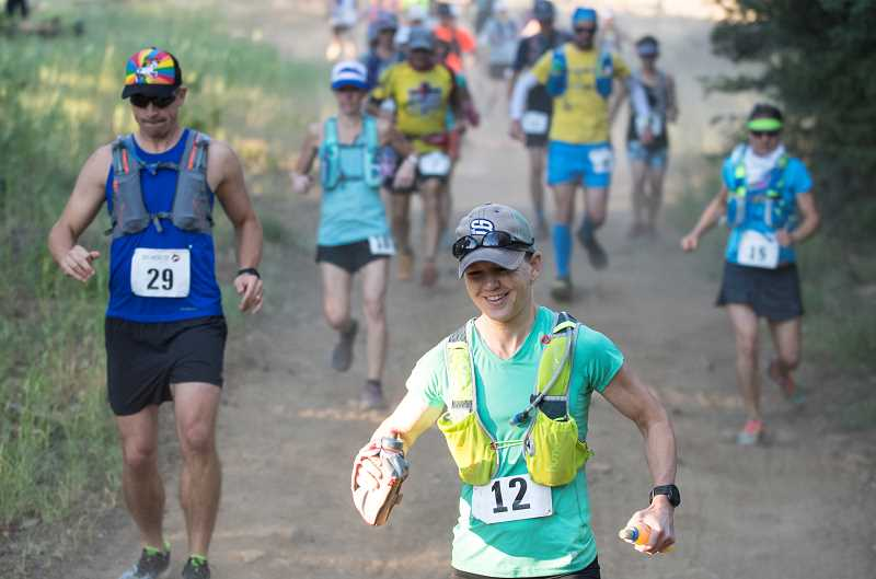 LON AUSTIN/CENTRAL OREGONIAN - Ashley Goodman leads a group of runners down a hill early in Saturday's 50K run. Goodman, from Boone, North Carolina, was the fourth woman finisher with a time of 6:50:13.