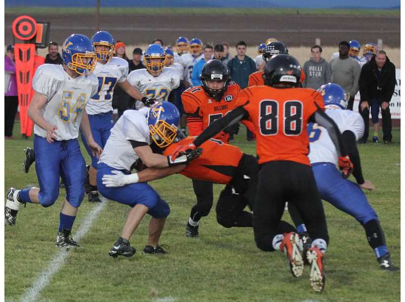 PIONEER FILE PHOTO - Culver will be in search of new leaders to emerge on both sides of the ball, but with players such as Victor Torres, seen here tackling a Vernonia ball-carrier on Sept. 23, 2016, the Bulldogs appear to be in good hands.