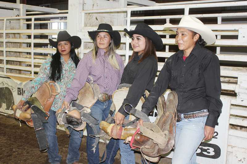SUSAN MATHENY/MADRAS PIONEER - From left to right, Charmaine Billey, Brianna Moore, Casi Hisatake and Whitley Ruiz, all of Warm Springs, will compete on separate teams in the wild horse race at Jefferson County Fair.