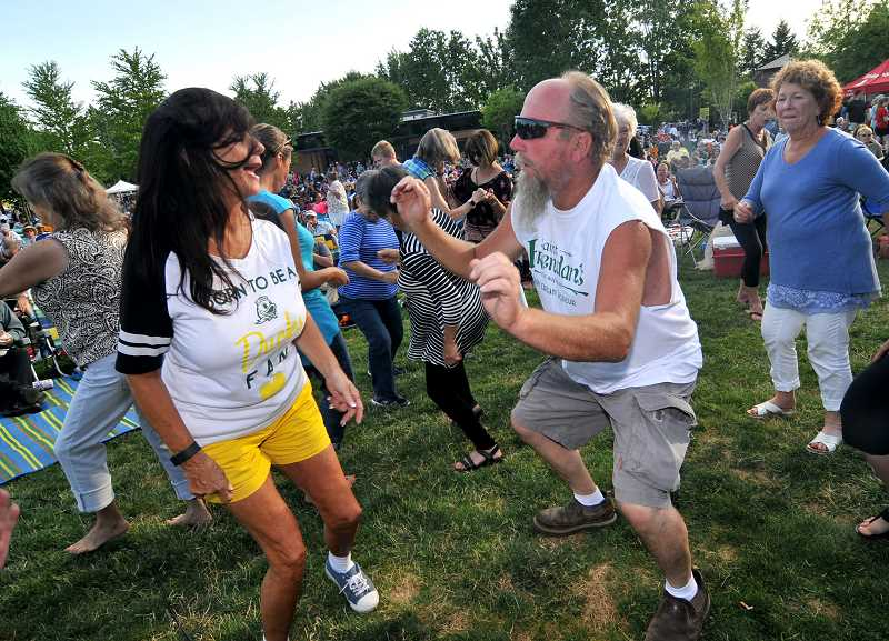 SPOKESMAN PHOTOS: VERN UYETAKE - Harold Weidemen and Dabbe Moody have fun dancing to the music of the Johnny Limbo & the Lugnuts at Thursdays Music in the Park in Wilsonville. For more photos of Music in the Park, go to page 12.