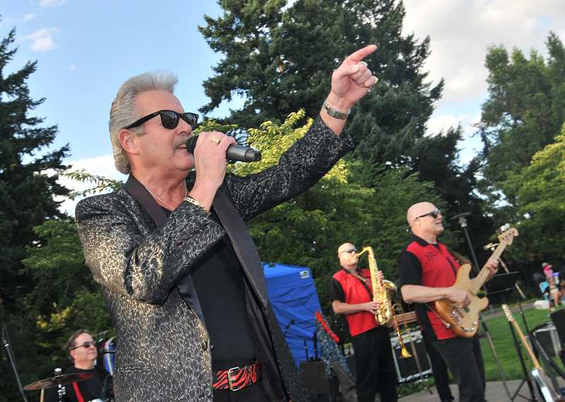 Johnny Limbo & the Lugnuts were a crowd-pleaserj in Town Center Park,  playing a lot of rock classics.