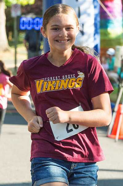 NEWS-TIMES PHOTO: CHRISTOPHER OERTELL - Forest Grove's Shelby Krieger, 11, starts the 5K at the Viking Vengeance race to benefit the Forest Grove High School cross country team.