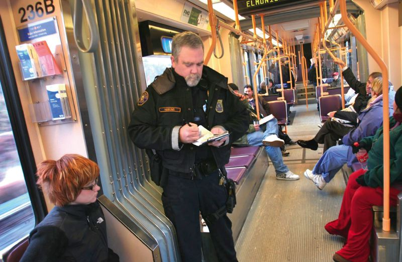 PORTLAND TRIBUNE FILE PHOTO - In the wake of a series of high-profile crimes on the TriMet system, riders wonder how much security, like this Transit Police officer checking fares, is enough.