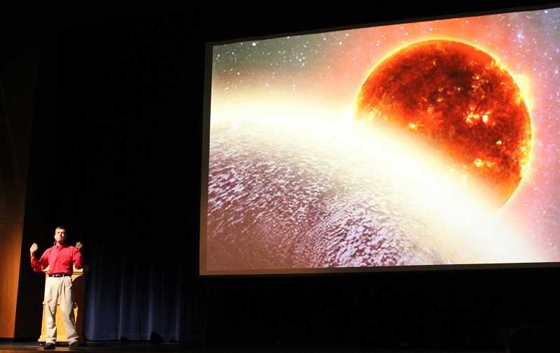 HOLLY M. GILL - Jeffrey Hall, director of Lowell Observatory, discusses the universe during a presentation July 10, at the Madras Performing Arts Center.