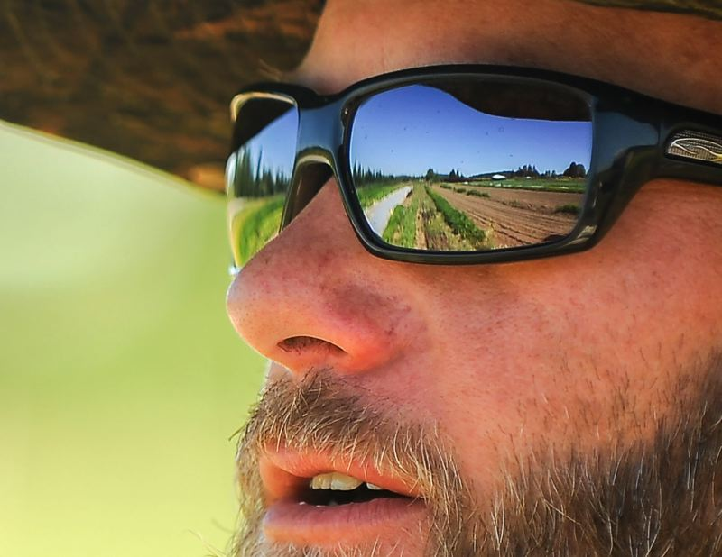 OUTLOOK PHOTO: JOSH KULLA - Brian Shipman of Wild Roots Farm looks across his plot at the Headwater Farms incubator.