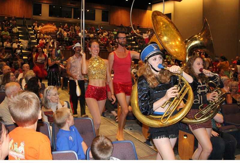 HOLLY M. GILL - Ethos music teacher, Sophie Pipia, of Madras, and her sister, Phina Pipia (on right), play tubas as part of the New Old Time Chautauqua's grand finale at the PAC Thursday, July 20.
