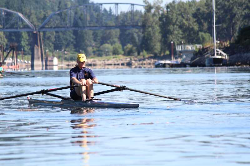 REVIEW PHOTO: SAM STITES - Roger Stevens didnt begin rowing on open water until he moved to Oregon. He began hitting the water with the help of Coach Matt Dorio early this spring, and has advanced his skills by remaining committed to his training.