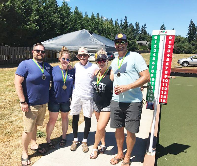 PHOTO COURTESY: BILL MARINELLI - Beaverton's Brew Crew, pictured with bocce advocate Bill Marinelli, center, won the fourth Donna Gedlich Memorial Bocce Tournament on Saturday, July 22, at Veterans Memorial Park in Scappoose.