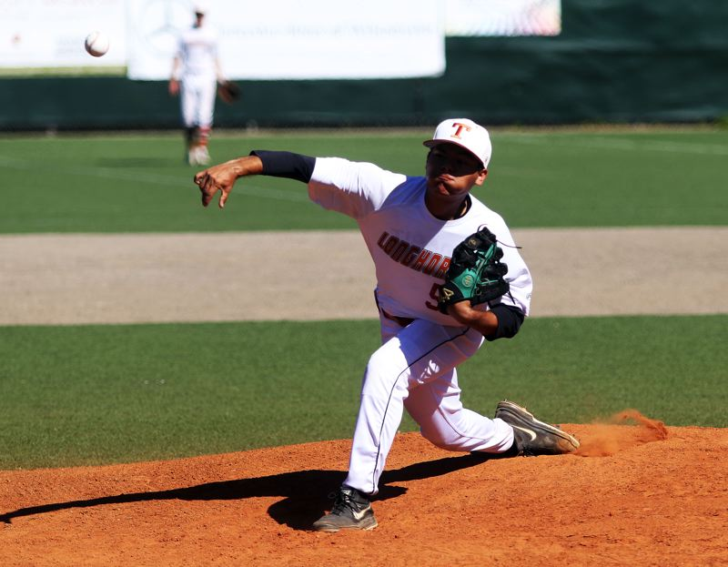 DAN BROOD - Tigard's Manny Andrade fires a pitch to the plate during the Longhorns' OIBA tourney win over Grant.