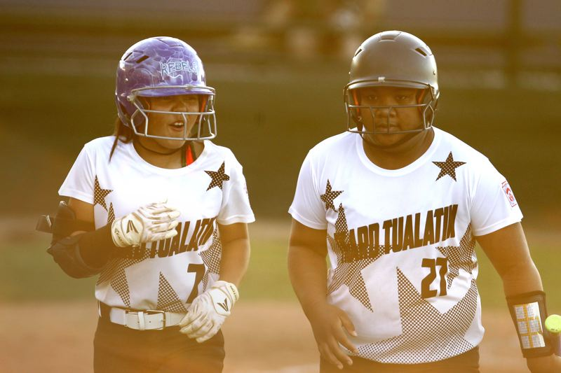 JAIME VALDEZ - Ava Carroll (left) and Kani Korok helped the Tigard/Tualatin City team get a 17-3 win over Tillamook.