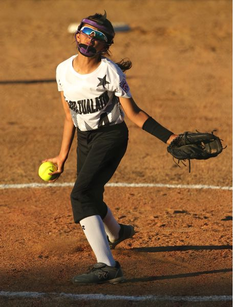 JAIME VALDEZ - Peyton Howard gets ready to fire in a pitch during the win over Tillamook.