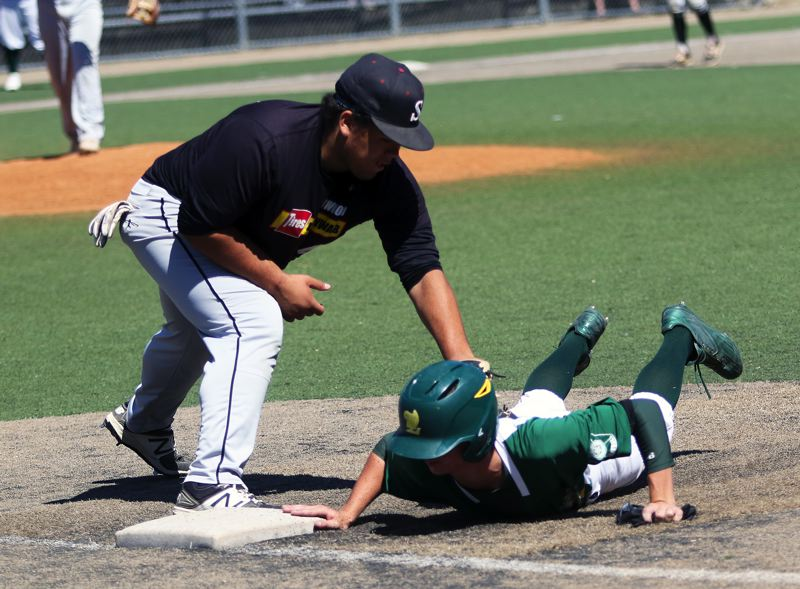 DAN BROOD - Sherwood first baseman Nic Garrison (left) puts a tag on a West Linn player during last week's OIBA tourney game.