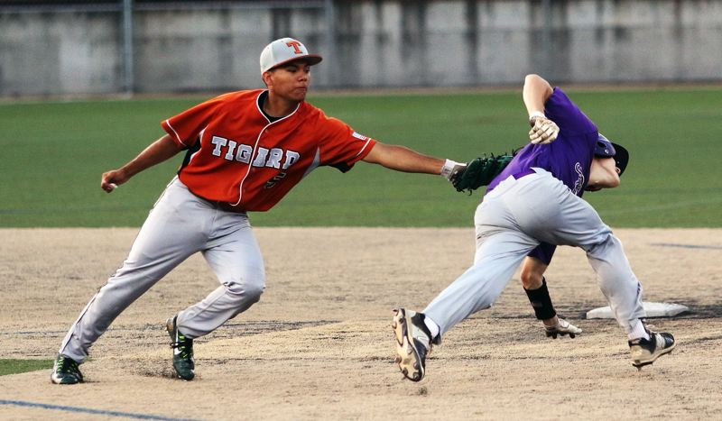DAN BROOD - Tigard Longhorns shortstop Manny Andrade (left) tags out Sunset's Jared Campbell during Friday's quarterfinal game at the OIBA state tournament.