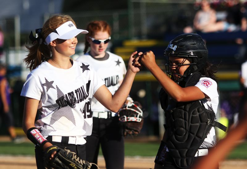 DAN BROOD - Tigard/Tualatin City pitcher Makenna Reid (left) and catcher Ava Carroll congratulate each other following the team's come-from-behind 6-5 win over South Beaverton on Tuesday.