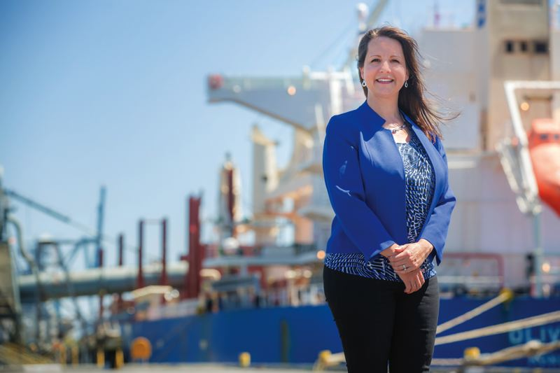 TRIBUNE PHOTO: JONATHAN HOUSE - Marler on the dock in front of a ship from which coils of steel wire are being unloaded. Marler fears the uncertainty caused by President Trumps talk of steel tariffs could cause a trade war. Her team are attempting to educate legislators on the ripple effects of protectionism.