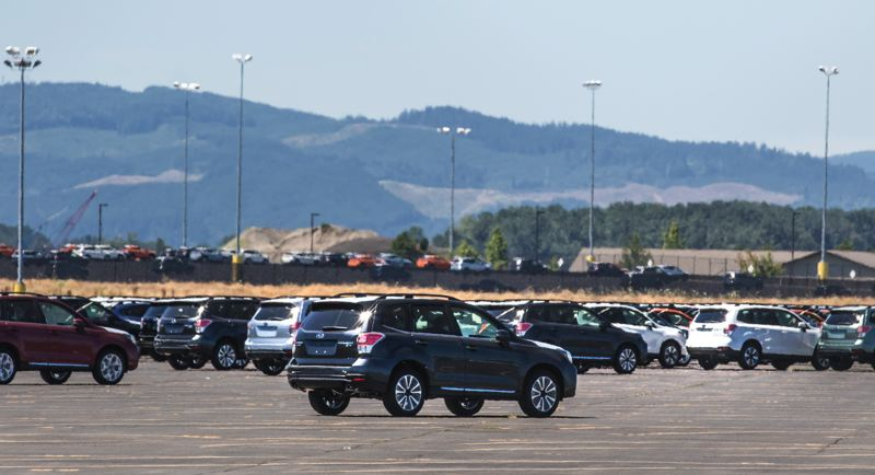 TRIBUNE PHOTO: JONATHAN HOUSE - Thousands of Subarus land at the Port of Vancouver where they are fitted with accessories before being transported by train dealerships across the U.S. Longshoremen can unload a ship in a few hours. Marler says the Port has a good relationship with unions - knock on wood.