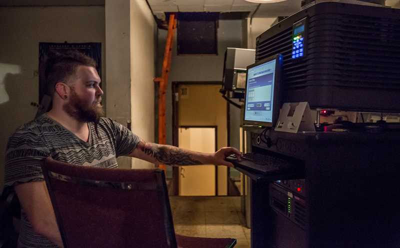 TIMES PHOTO: JONATHAN HOUSE - Casey Martin runs a projector at the Valley Cinema in Beaverton.