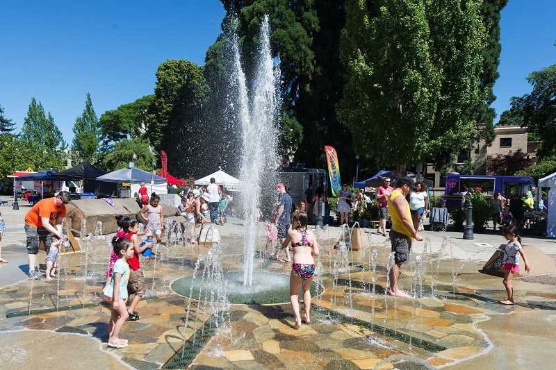 HILLSBORO TRIBUNE FILE PHOTO: CHRISTOPHER OERTELL - Kids play at the fountain in front of the Hillsboro Civic Center in June. Hillsboro is forecast to reach 108 degrees this week.