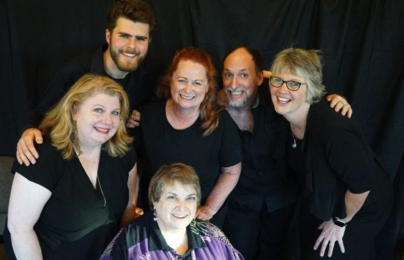 SUBMITTED PHOTO - Cast members surround Susan Scovil, center, founder and artistic director of Rising Phoenix Theater.