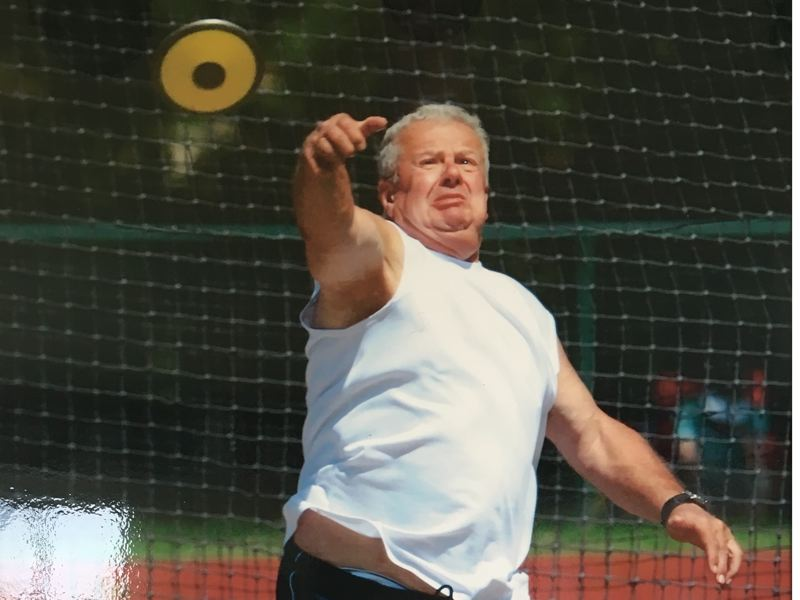 PHOTO COURTESY OF WAYNE SABIN - Milwaukie's Wayne Sabin, 84, sen here throwing the discus, holds the American indoor record in the  super weight throw for the 80-84 age group with a mark of 29 feet, 6 inches set in 2014.