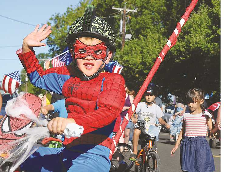 GARY ALLEN - The kids parade on Thursday drew hundred of youngsters, and their parents, to the streets of Newberg