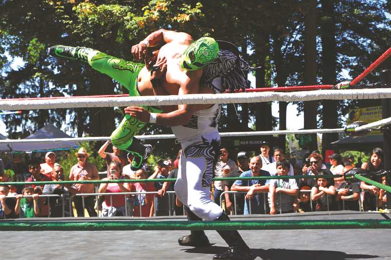 INDEPENDENT FILE PHOTO - Lucha Libre wrestlers, pictured here in 2016, draw a crowd at Fiesta Mexicana.