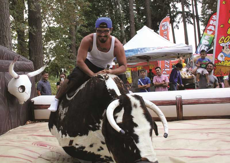 INDEPENDENT FILE PHOTO - The event offers many activities, including the opportunity to ride a mechanical bull (pictured in 2015).