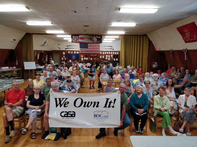 SUBMITTED PHOTO - On July 22, dozens of residents of Gladstone Mobile Home Park gather at the VFW Post 1324 meeting hall in Oregon City to celebrate their recent purchase.