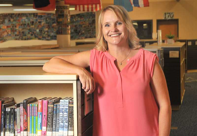 SPOKESMAN PHOTO: VERN UYETAKE - Kelly Schmidt comes to Wood from Gardiner Middle School in Oregon City, where she was principal for the past six years.