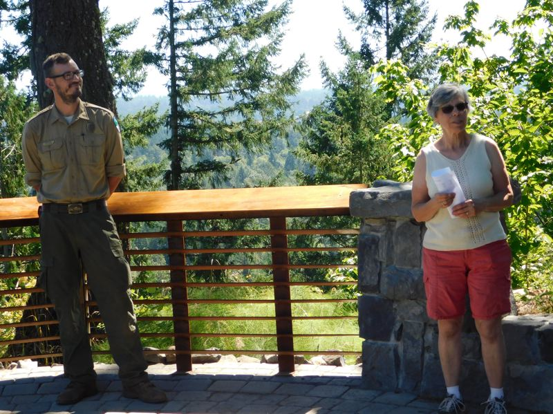 ESTACADA NEWS PHOTO: EMILY LINDSTRAND - Leaders from Milo McIver State Park and Trailkeepers of Oregon discuss a recently completed trail during a dedication event on Saturday, July 29.
