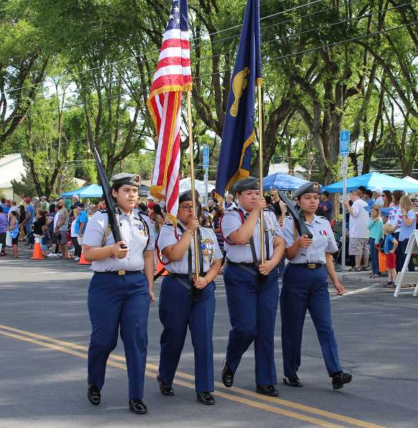 FILE PHOTO/MADRAS PIONEER - The JROTC color guard leads the Fourth of July Parade in Madras.