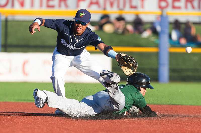 HILLSBORO TRIBUNE PHOTO: CHRISTOPHER OERTELL - Pioneer League all-star outfielder Amalani Fukofuka #8 slides safely into second base as Northwest League all-star Manuel Geraldo tries to make a play during the 2017 All-Star Game at Ron Tonkin Field in Hillsboro, Oregon.